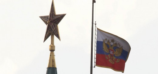 A Russian national flag flutters in half mast near a star on the top of a Kremlin tower as Moscow holds mourning for the victims of victims of Tuesday's metro accident in Moscow